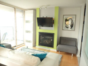 FURNISHED, BRIGHT 1 bedroom and den with PARKING