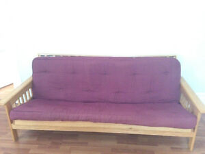 Solid Oak Futon, great for students to have the extra couch/bed!