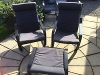 Two IKEA poang chairs with footstool