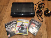 PlayStation 3 with controller and 3 games .