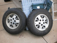 TWO 235-75-R 15-IN TIRES ON NICE RIMS
