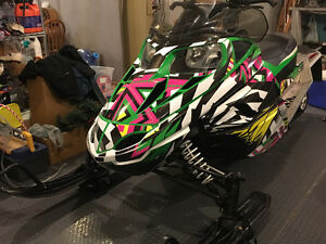 "2011 Arctic Cat F570 with 1.5"" ripsaw track and sled wrap"