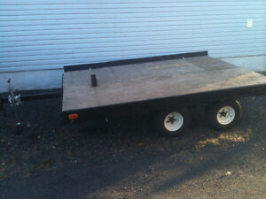 flat dual axle tailer trade for  3 or4 machine enclosed trailer