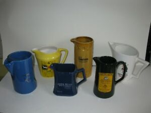 Group of 6 Whisky Pitchers