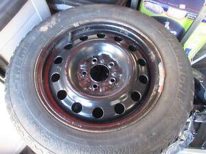 16 in. snow tires on rims 205/65R16 on 16 in. rims