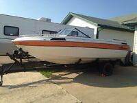 21 foot boat and trailer with cuddy cabin