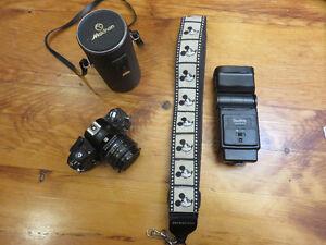 Nikon camera, makinon lens, starblitz flash and camera strap.