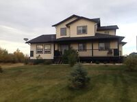 Room for rent in executive home in Sexsmith  available Feb 15