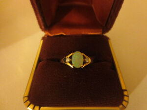 Opal ring with diamonds