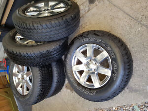 """18"""" factory Jeep rims and tires $800"""