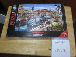 assorted jigsaw puzzles not opened still in original pkg's. firm