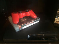 PS3 with 2 games and 1 remote control/ PS3 + 2 jeux + 1 manette