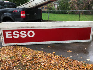 2 signs With or with out the red Esso