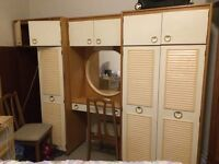 Wardrobe with white fronts and mirror