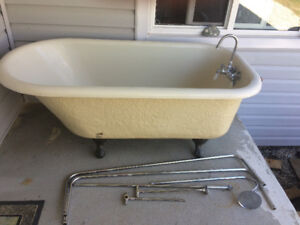 Claw foot tub with all taps and curtain accessories.