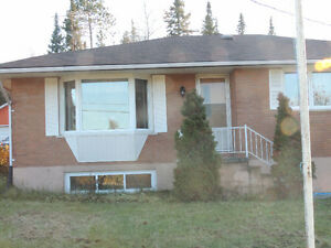 READY TO MOVE IN - BUNGALOW WITH LARGE YARD AND GARAGE