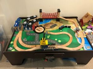 wooden train table and track