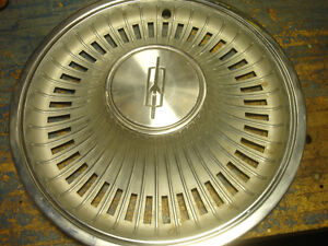 Four vintage 1972 Olds Cutlass wheel covers