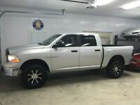 2009 Dodge Ram 1500 crew cab with 3'' lift kit