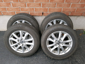 """205/60 16"""" OEM Mazda 3 alloy rims and tires excellent condition"""