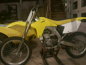 2006 Rmz 450 (firm-(Tiny township) reduce 500$