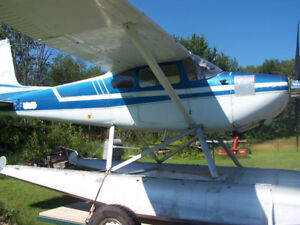 1958 Cessna 180 on EDO 2870 Floats