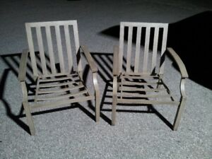 Two heavy duty metal patio chairs