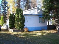 Mobile Home with additions located on the Hart *reduced price