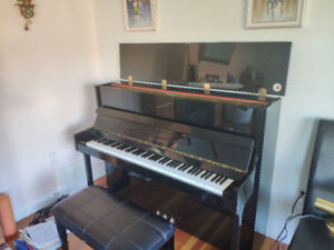 Ottostein Piano in excellent condition with matching bench.