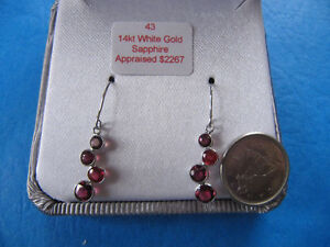 A pair of brand new 14k white gold ruby earrings