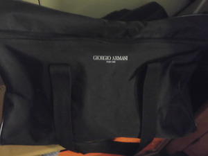 Georgia Armani duffle bag