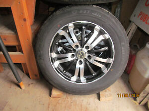Summer tires mounted on mag rims Peterborough Peterborough Area image 1