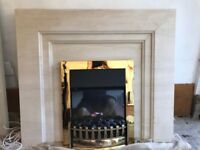 Limestone fire place surround with electric heater