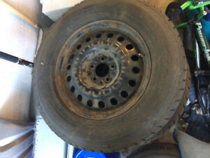 245/65R17. 4 tires on rims with sensor & hubcaps