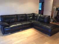 Black leather corner sofa a year old