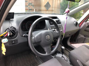 SUZUKI  SX4 AT FWD SEDAN