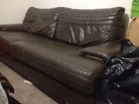 Large 4 seater brown leather sofa