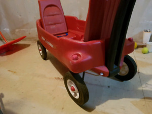 Two child wagon with flip up seats.