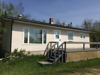 Move in Ready Bungalow on 77 Acres by Teulon