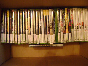 Box of various Xbox 360 games