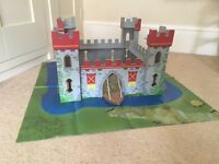 Wooden castle with drawbridge and play mat