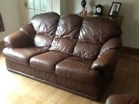 Leather brown sofa chair and pouffe