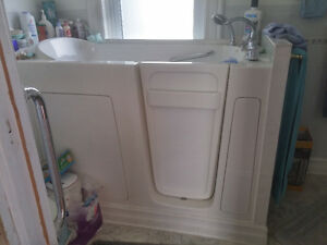 "Nearly New Walk-in Bathtub 55""l x 28.25""w x 39""h"