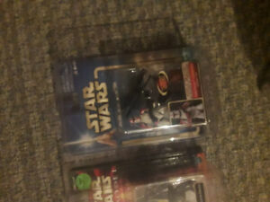 Three Star Wars Figures With Protective Covers