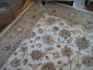 Beautiful hand-made 100% wool carpet, just over 9 x 12 feet