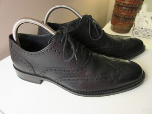 NEW!  Men`s black dress/casual shoes, size 9R.  Cole Haan