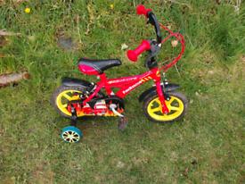 Boys bike with stabilizers