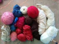 bag full of leftover yarn, different colors,