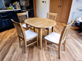 Oak extendable dining table with 4 chairs