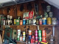 Antique motor oil cans and advertising signs